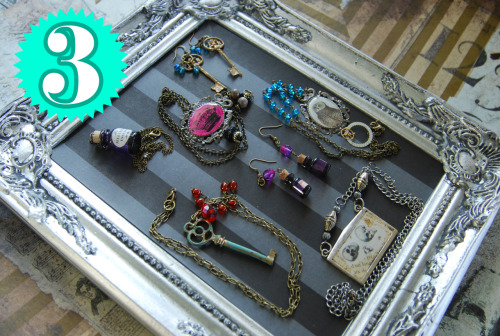 "vaenox:  VAE NOX HANDMADE JEWELRY GIVEAWAY! http://www.etsy.com/shop/vaenox +++++++++++++++++++++++++++++ My jewelry style has changed over the weeks and the months, and I recently discovered a stock of objects that don't really go along with what I'm doing now. That's why I'm doing this giveaway, with 3 amazing prizes to win! Here are some informations: • To participate, REBLOG or LIKE this post as much as you want (it increases your chances to win, but avoid over-reblogging, because I'm not sure that your followers will appreciate ) ;) • DON'T EDIT this post when you reblog it. Just let it like that. • The giveaway ends on 26.06.12 • You won't have to pay anything if you win. I pay the shipping fees. • I ship worldwide so everyone can participate! • I will randomly pick 3 winners with the website random.org. • If you are one of the winners, I'll inform you here on tumblr. So be attentive and keep your ask box open! If you don't answer quickly I'll pick someone else. The prizes… PRIZE N°1:  Antique brass camera necklace /Turquoise & brown howlite skulls stretch bracelet / ""Amulet"" necklace with a round gold locket / Botanical Garden necklace with moths under a glass cabochon & skeleton key / Blue miniature bottle earrings / Blue & grey beads earring / Verdigris patina dangle earrings PRIZE N°2:  Skeleton cameo necklace / Red miniature bottle earrings / Purple dragonfly necklace / orange miniature bottle earrings / Victorian tin type necklace / Metallic fishes necklace / Howlite cats earrings PRIZE N°3:Miniature bottle necklace with ""Jellyfish Essence"" written on it / Pink crown necklace / Golden skeleton keys earrings / Verdigris patina skeleton key necklace / Purple miniature bottle earrings / Owl necklace with antique watch parts / Anatomical necklace with skulls. Good luck to everyone!! Ysatiss Vae Nox"
