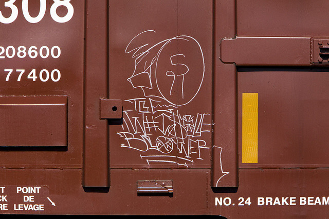 ~ Whistleblower ~ Graffiti on a Train in Auburn, WA 6-25-11 by xXxBrianxXx on Flickr.