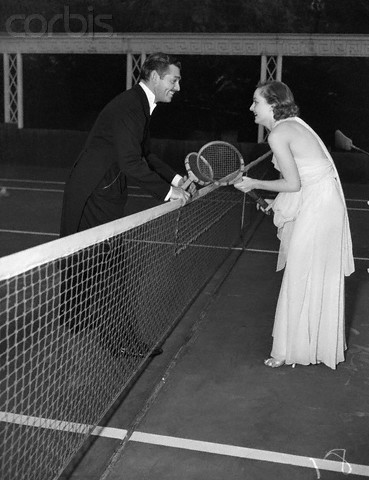 As Wimbledon nears, here's a picture of Clark Gable and Carole Lombard getting ready to play a game of tennis in evening wear!