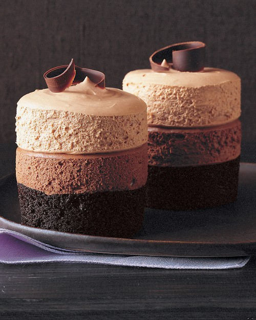 lickystickypickywe:  Triple-Chocolate Mousse Cake The dark-chocolate cake at the base is baked in ramekins. Two layers of plush, pillowy mousse — bittersweet and milk chocolates — are piped on top and capped with semisweet chocolate curls.  Give this to me right now