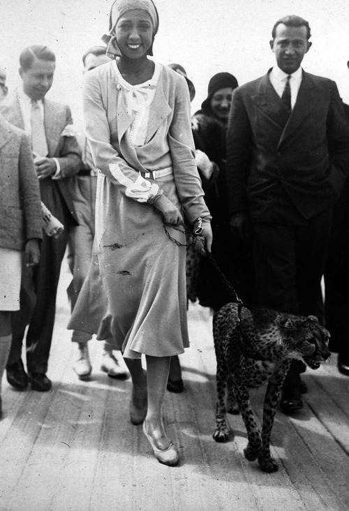 Josephine Baker takes her pet cheetah Chiquita for a walk, 1931