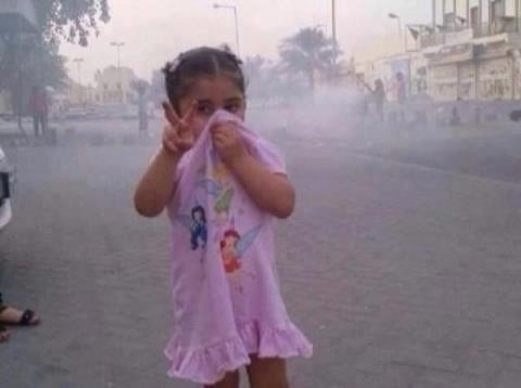 An angel raising victory sign in the middle of tear gas attacks and repression!