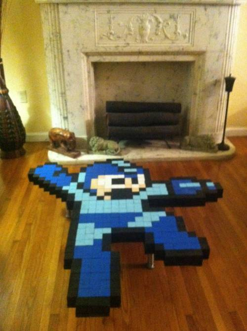 i made this sculpture of MEGAMAN, couldnt figure out what to do with it so i made him into a coffee table.