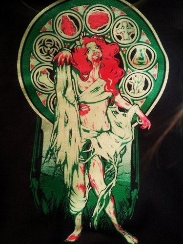 so my zombie art nouveau hoodie just arrived, though i almost missed the mailman after being gripped with fear when the doorbell rang and not wanting to answer. i'm quite pleased with it. my only issue is that on the website it looks like the background is black. in that photo i just took, it looks black. and yet sitting right in front of me i promise you it is in no way black. it's brown. which i'm not gonna lie, is a bit disappointing. if you don't have an option when purchasing it on the website to pick the color, and the photos all make it appear as if it's black…one would assume there is only one option available-black. false. i just feel like they should have put a disclaimer in there or something.  but what can ya do? also in the box was this sticker:  which i have zero use for and am not sure what's gonna happen with that.