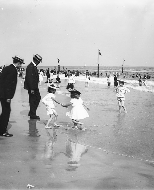 On the beach at Rockaway, N.Y., c. 1900.