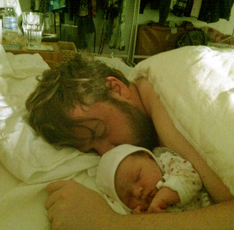 soundasapound:  Me with my daughter Seren having a chill after she was born last night.  Hi, I'm uncle Aaron.
