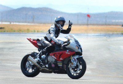 "Valerie Thompson on her stock BMW S1000RR, being generally bad ass. Valerie Thompson, owner/driver of the Valerie Thompson Land Speed Racing Team, joined an elite group of ""Mojave Magnum 200 MPH Club"" members at this premier event when she piloted her Martech Services Company BMW to a top speed of 209.5 mph over the new 1.5-mile course on June 2 in Mojave California, reportedly making it the world's fastest production BMW S1000RR. Teammate Bob Sellers recorded a top speed of 219.5 mph on his Suzuki Hayabusa. (bmwmoa.org)"
