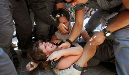 "Police Violence Escalates in Israel as Social Justice Movement Reignites  June 23, 2012 Public Security Minister Yitzhak Aharonovitch should not be allowed to forget these pictures, nor should Police Commissioner Yohanan Danino or Tel Aviv Mayor Ron Huldai (a retired brigadier general): Five police special unit officers – maybe six – drag protest leader Daphne Leef out of a group of demonstrators on Rothschild Blvd. in Tel Aviv and onto the opposite sidewalk. Leef, in a blue shirt, is thrown to the ground. A few meters away, municipal inspectors and Huldai's ""Green Patrol"" help the police push back the protesters. Every few minutes Leef tries to raise her hands and protect herself from the shoves and kicks, to no avail. In the background, the crowd repeatedly shouts one word: Democracy. This horrific sight lasted for many minutes, until Leef was forcefully taken to a nearby police vehicle. No one should ever ignore or repress these pictures. If the prospect of a renewed summer social protest needed a little spark to get angry, raging Israelis back on the street, the police's special unit officers and Huldai's municipal inspectors generously provided just that; the disproportional use of force against Leef – one woman vs. five-six officers, and later against other protesters – tainted the events on Rotchild. The brutality from above was not only direct, it was public and unabashed. The 300 activists who remained on the boulevard after the arrests decided on a swift response to counter the silencing of their voices: A protest march on Saturday evening, directed not least at mayor Huldai. There are more protests planned in the near future, but even the movement's leaders know that the events of last year cannot repeat themselves. They don't need to, either, as they will manifest themselves according to today's reality. The protest is still here, because very little – if at all – has changed since last summer. Source"