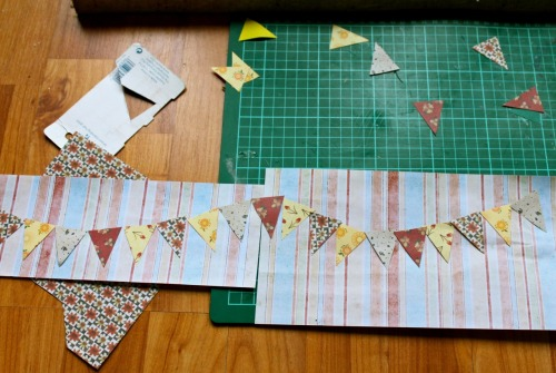 I made some miniature bunting for the bedroom set today with some origami paper I forgot I had.