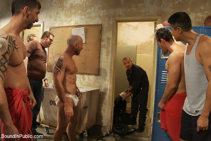 more bullies at work……..bunch of dudes in the locker room all horny 4 action, they see the sexy construction guy with shaved head……they decide to out wrestle him 2 force there way……    its amazing what a little wrestling can do…….