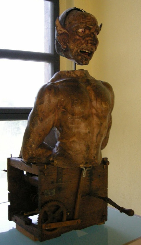 "Italian Automaton (The Devil), carved in wood, 15th and 16th centuries,it could ""roll its eyes and move its tongue, emit a noise and spit smoke from the mouth."