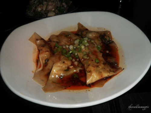 King prawn wontons with aged black vinegar dressing.
