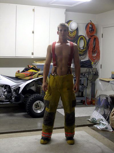 Sexy shirtless young firefighter in his garage.  Hot!