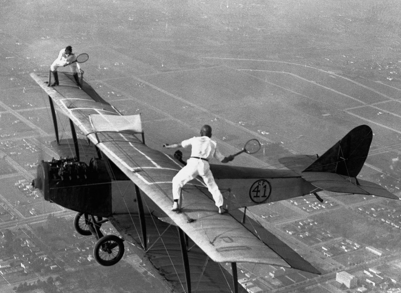 Daredevils playing tennis on a biplane above Los Angeles, 1925.