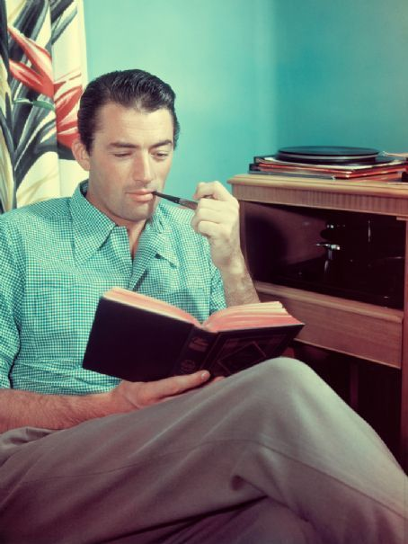 What a beautiful man Gregory Peck was.  New goal: Making sure my outfit's color scheme matches the wallpaper.   avasgal:  Gregory Peck looking great while reading.