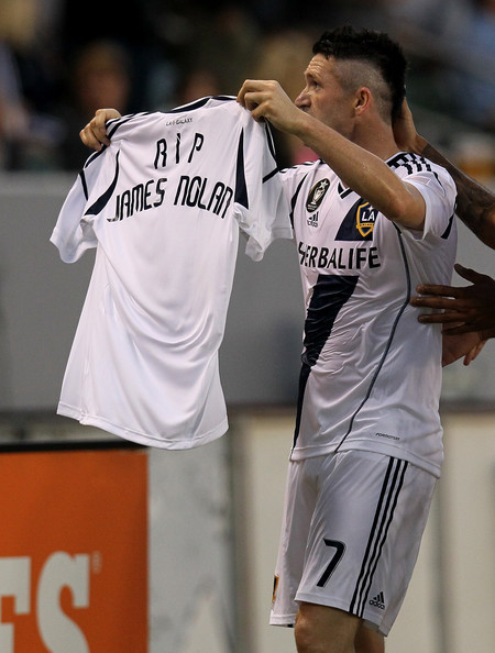 "calcio-nel-cuore:  Robbie Keane, captain of Ireland's football team, who now plies his trade with the Los Angeles Galaxy of Major League Soccer, holds up a jersey printed with the words ""RIP James Nolan"" after scoring against the Vancouver Whitecaps in honour of the Irish fan found drowned in a canal in the Polish city of Bydgoszcz. Nolan had travelled to Poland to support the Men In Green at Euro 2012. He was 21. RIP, James."
