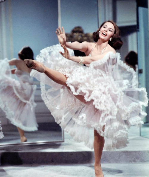theniftyfifties:  Cyd Charisse kicks up her heels in 'Silk Stockings', 1955. Photo by J.R. Eyeman.