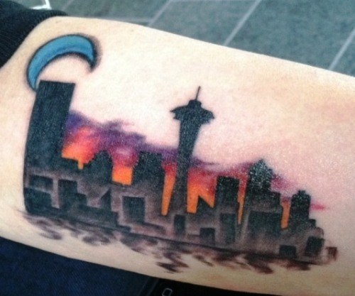 This actually was a cover up but you can never forget where home is.  Done by Alan from Pierced Hearts in Seattle, Washington.