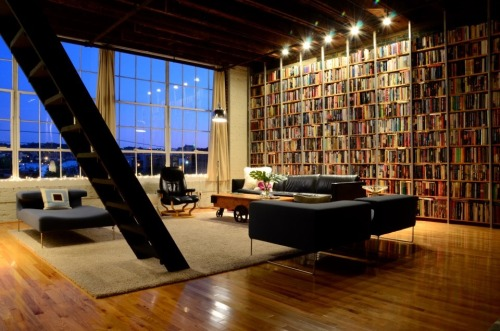 bookshelfporn:  A bookshelf wall in the loft of one of our readers in Birmingham, Alabama.