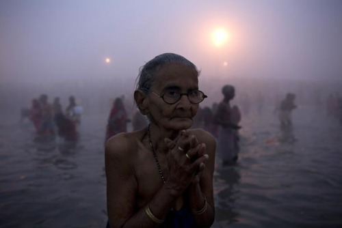 delucazade:  Woman praying in the Ganges River, India Rajesh Kumar Singh/AP TribalPrintedBeauties: Hippie/ Peace Blog