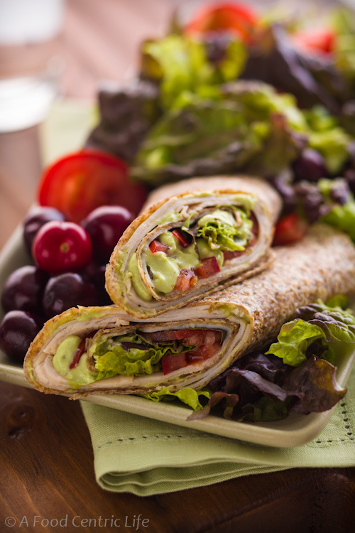 Turkey-tomato tortillas wraps with a yogurt-based avocado cream. Soft sprouted grain tortillas add great protein and fiber. Lunch and picnic Recipe