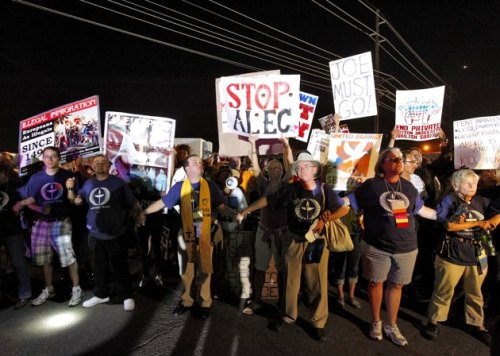 "Sheriff Joe Arpaio's ""Tent City"" subjected to mass protest: Last night, thousands of people protested outside of the outdoor facilities that Maricopa County, Az. uses to jail its prisoners, a cost-saving measure implemented by Arpaio which many consider inhumane. Many of the protesters wore shirts and held signs that said ""Standing on the side of love,"" which is a slogan used by the Unitarian Universalist Association. The religious group was holding a convention in nearby Phoenix this weekend. (photo by Matt York/AP)"