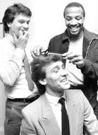 Brian Robson gets a haircut from Cyrille Regis