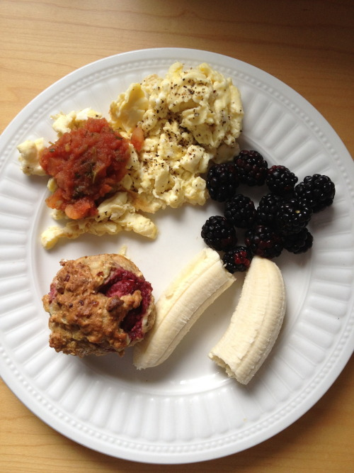"themodesttellurian:  Breakfast: scrambled eggs with salsa, banana, blackberries, berry ""health muffin""."