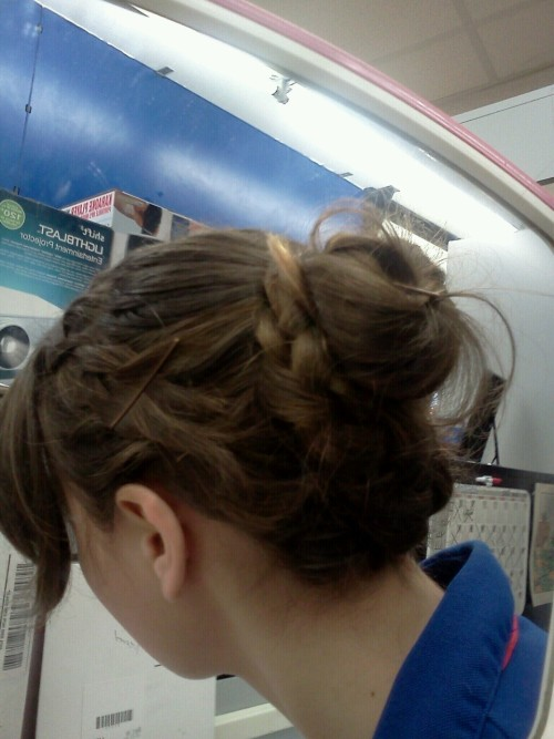 I wish I could show my whole head, but I tried out this hairstyle today. Its a bit messy, but whatever. :)