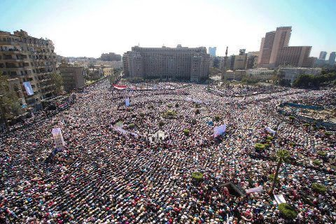 Egyptian protesters praying today in Tahrir square after Dr. Mohamed Morsy the won the presidential elections