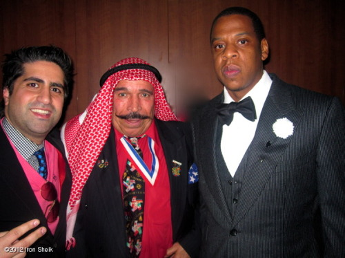 Here's a picture of Jay-Z with the Iron Sheik.  Yes, THAT Iron Sheik.  I wonder if he put Jay in the Camel clutch?  (Was that too obvious of a joke?  I'm sorry.)