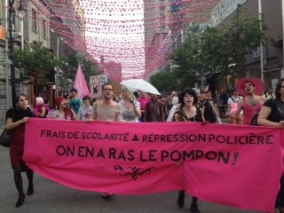 Queer & feminista! Anticapitalista! The queer pink bloc march exhibits a fierce defiance against the police in Montreal.