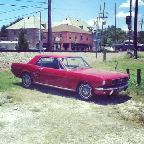 Now this, I like! 😏 #niceride #mustang #car #old #vintage #love #motor #neworleans #street #traintrack #red #awesome #smile #ipod #instagram #parked #outside #sunday #sunny  (Taken with Instagram at New Orleans, LA)