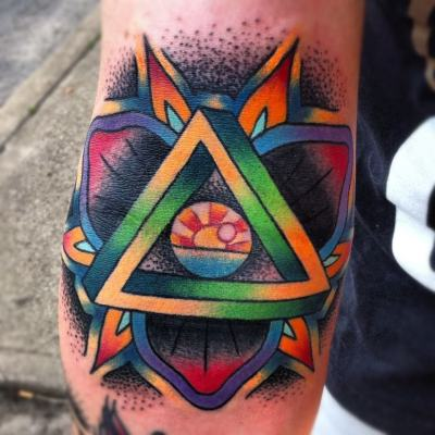 "This tattoo was done by someone who has become a good friend of mine, Phil DeAngulo at Cap City Tattoo Co. in Columbus, OH. The main focus of the tattoo is the sunrise inside of the eyeball, which comes from lyrics of a Darkest Hour song. ""And when I can wake up to see the sunrise in your eyes, then we'll finally be free and I'll know I've made it home."" There is also an impossible (penrose) triangle which signifies that nothing is impossible if you put your mind to it."