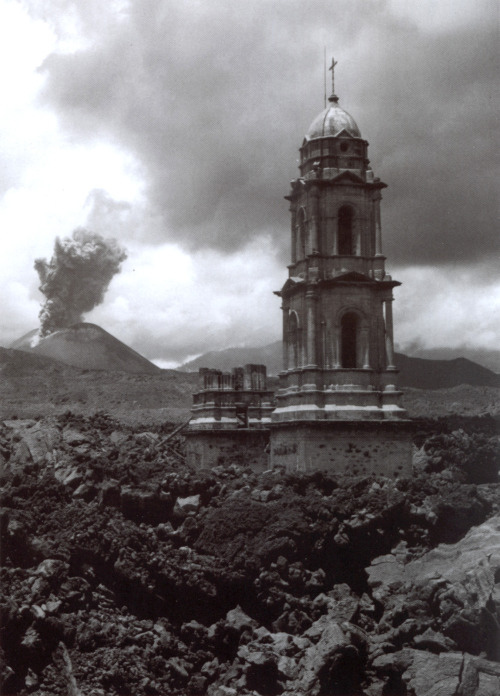 Juan Rulfo. Paricutin volcano and the church of Parangaricutiro buried by the lava, Mexico, 1945
