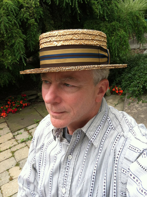 What hat are you wearing today? It would be an early 20th C. straw boater. I just finished replacing the ribbon on this one (a really tall brown job that was way off the golden ratio and disintegrating to boot) with a nice striped piece of grosgrain from a stingy brimmed straw that I never wear. I rather like it.  Here are a few additional pictures of this rustic old beauty.