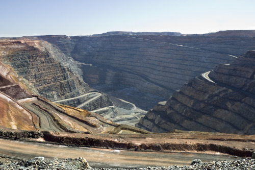 Much has been said about the changing face of the mining industry, where the effects of the boom have been both substantial and positive. But until very recently there has been far less discussion of the impact of the mining boom on the rest of the economy, including those areas which have suffered as a result.While one might assume that any expansion in the mining industry simply adds to the overall size of the Australian economy, in reality the operation of the macro economy is far more complex. Indeed, much of the growth in mining comes at the direct expense of expansion in other parts of the economy.According to the findings of a survey by the Australia Institute the average Australian thinks that 16 per cent of Australian jobs are in the mining industry and that 34 per cent of GDP comes from mining. In reality only 1.9 per cent of people work in mining and they produce less than 10 per cent of GDP.The mining industry has undergone a huge boom in the past decade with its employment surging from 78,400 in 2001 to around 210,000 today. To put that in perspective, however, there are around 22 million Australians. In Western Australia 88,000 people are employed in mining, and in Queensland it's around 62,000 or put another way, 97 per cent of Queenslanders don't work in the mining industry.Nationwide the mining industry employs slightly fewer people than the leisure and recreation services industry, around one third of the number of people who work in the community sector and about one fifth of those who work in manufacturing.Of course the mining industry also creates indirect jobs – but there is much less acknowledgement of the indirect jobs that are also created when teachers, nurses and retail workers spend their earnings.But while the mining industry is keen to claim credit for the indirect jobs it creates in other industries, it is not so keen to accept responsibility for the impact of the mining boom on the exchange rate and for the decline in employment in other industries.As the world's demand for our resources has boomed so too has our exchange rate which has risen from an average US$0.74 in 2004 to over US$1 this year. There has been much said about the potential impact of a carbon price on competitiveness but the increase in the exchange rate has been devastating for major parts of the manufacturing, tourism, education and agriculture industries.The mining boom is also largely to blame for Australia's relatively high interest rates. When the RBA increases interest rates its goal is not to slow down the mining industry but to slow down the rest of the economy in order to make room for the expansion of the mining industry.This means that both small businesses with an overdraft and families with a mortgage are paying a high price for the big profits of the mining companies. The fact that 83 per cent of those profits are actually paid to foreigners, like the fact that the mining industry pays one of the lowest rates of corporate tax, is strangely absent from the glossy mining advertisements.So what, if anything, can government do to insulate the bulk of the economy from the surging exchange rate?The government could broaden the base of its proposed mining tax to include, for example, the enormous profits being made by gold miners.Having done so, if the government were to create a sovereign wealth fund which invested heavily offshore the short-term outflow of money would take some pressure off the exchange rate. By moving money offshore when the exchange rate is high, Australians will receive a substantial capital gain when the money is brought back onshore when the boom begins to bust.They could also slow the rate of mining expansion. The mining industry is currently planning massive new investments in coal, iron ore, coal seam gas and other mineral extraction.The faster this expansion occurs the greater the pressure on our exchange rate and interest rates will be. That is, the faster the mining boom is allowed to proceed the greater the risks to the broader community will be.The Australia Institute has published an analysis of the mining boom – Mining the truth: the rhetoric and reality of the commodities boom. Dr Richard DennissExecutive DirectorThe Australia Institute