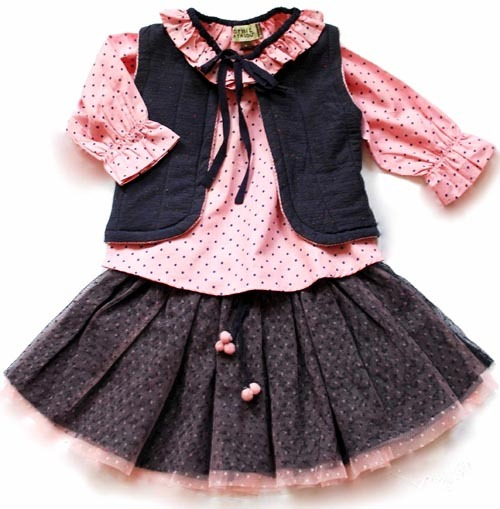 FALL 2012 KIDS FASHION PREVIEW: Pom-poms, polka dots and ruffles: buyers are responding to Sophie Catalou's freewheeling styles for Fall 2012. One look they love: the elegantly colored Blush Dot Peasant Top and Cotton Vest worn over the elastic waist, cotton-lined Mesh Skirt with pom-pom trim and a mock drawstring tie. (Most styles fit 12 months to 12 years).