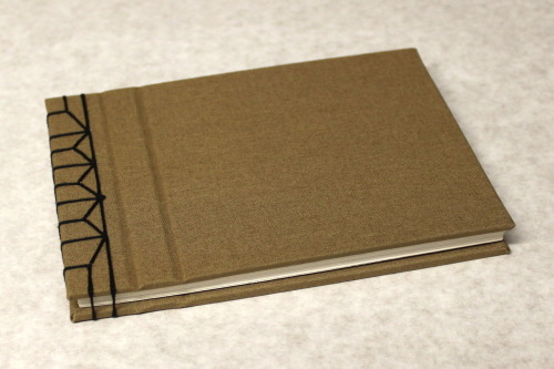 Finally my sketchbooks are on sale at Etsy! Link: HERE Please reblog & buy. As an illustrator I was frustrated by lack of choice when it came to sketchbooks. I wanted something beautiful, stylish and unique to work in that reflected my tastes as an artist. Eventually I decided to learn to make my own sketchbooks, learning all the steps of binding books to make a professional product. After working on these for several months I realised that other people might enjoy them too.These books are perfect as a sketchbook, diary or even for taking notes in. Each Lunar book consists of 60 sides of the finest A6 sized 160gsm cartridge paper. They have been hand bound by myself with covers in a beautiful sandy golden Colorado book cloth and stitched together with thick strong black thread. Completely crafted and designed by myself, these sketch books are part of a series of 'Lunar' books subtly decorated with moon phases and shapes on the end papers.