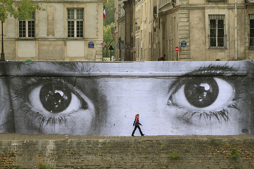 in-the-wall:  Street artist JR in Paris.
