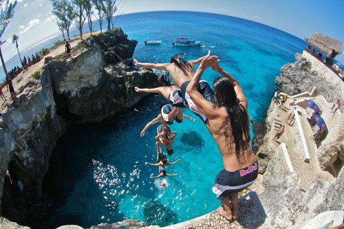 Cool time-lapse photo of a guy cliff diving into a cove