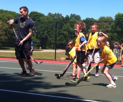 "Bruins defenseman Andrew Ference spent his Sunday helping the Emerald Necklace Conservancy by hosting a series of youth street hockey clinics at Franklin Park in Boston (Photo: Boston Bruins).""We have a ton of parks and some beautiful areas in Boston,"" Ference said following the event. ""The greater picture is just kind of getting people out into the outdoors and enjoying Boston's wealth of parks and great places for kids to come out.""Read the full story here."