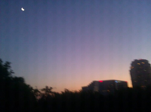 "Halfway home. a little blurry, but there's the moon on the left!  Listened to Foster the People…and some other stuff ""I run they run everybody run run, And we're all just having fun"" ha ha!"