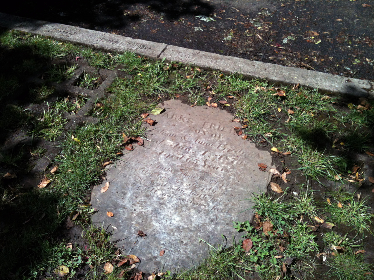 Never noticed this before. Gravestone embedded next to the sidewalk ~SE 35th & Taylor.
