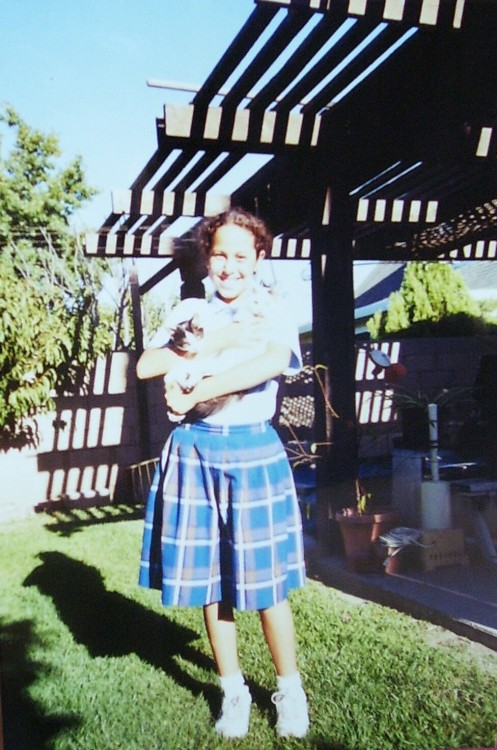 Me in third grade (I think) explains the uniform. With my two kitties, Precious and Angel (brothers, L-R). In Grandma and Grandpa's backyard. Sporting a super sweet tan. This picture reminds me of so much, mostly good things. I miss the old house.
