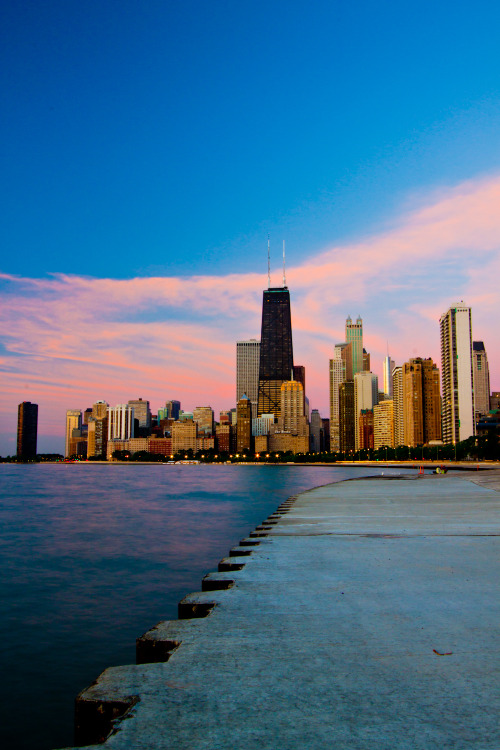 Metropolitan Dawn Photo of the Chicago skyline taken this past weekend just before sunrise. The clouds above looked like a purple fish net that was about to capture the city in its entirety. If you would like to see a larger sized image or buy a print, click on the photo to visit my photography website.