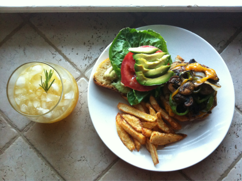 Food from my phone | Early summer supper  Indian spiced turkey burger with cheddar, grilled mushrooms, onions, and green chili on grilled sourdough. Paired with garlic fries and passion fruit lemonade.