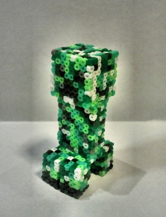 ianbrooks:  3d Hama Bead Geek Trinkets by Matthew Kibble All items available for purchase at etsy. Harnassing the power of ALL three dimensions, Matthew creates miniature geekelry out of hama beads and ingenuity: the Question Mark Box and Zelda Treasure Chest both open to hold your delicate unmentionables, the Minecraft Creeper's head spins Exorcist-style, and the Portal Companion Cube opens up to reveal an even smaller Companion Cube inside, just like a russian doll.  Artist: deviantart / twitter