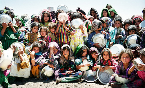 fahedtarmoom:  A group of young Afghan girls wait patiently in the mid-day heat to collect their ration of soup, available every other day. Photography: Marcus Perkins
