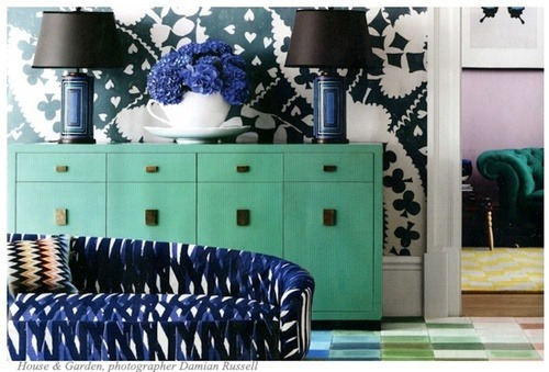 Source: Damian Russell So bold and bright. Love the turquoise sideboard set amongst the darker navy. So good! The sofa fabric is Christopher Farr and it comes in 5 colourways. Hard to choose which I like best! check it out :)